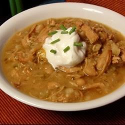 Slow Cooker Turkey and White Bean Chili Recipe - Shredded turkey breast meat joins with hominy and white beans for a flavorful, Mexican-inspired chili that doesn't contain tomato.