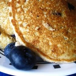 Mom's Oatmeal Blueberry Pancakes Recipe - These pancakes were a regular feature on Sunday mornings when I was growing up. They're still the best I've ever had. Buttermilk pancakes with oatmeal and blueberries.