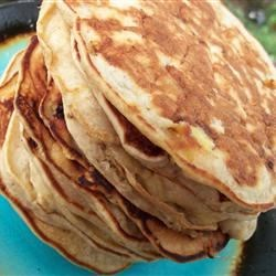 Awesome Banana Pancakes Recipe - The reaction between the bananas and the buttermilk combined with the dual action baking powder makes these pancakes super fluffy. Huzzah for science!