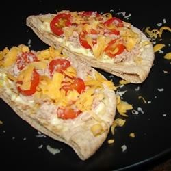 Tuna Pita Melts Recipe - This is a quick and easy twist to your average tuna melt, and it looks and tastes delicious.