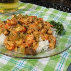 Go-To Crawfish Etouffee Recipe - A simplified but delicious version of this Cajun favorite takes it from a once-in-a-while special treat to a weeknight favorite. You don't slave over a traditional roux, and the recipe only takes 40 minutes.