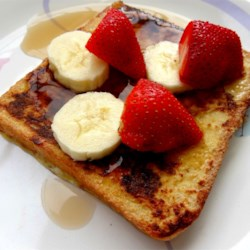Fluffy French Toast with Syrup, Strawberries, and Bananas