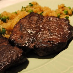 Venison Tenderloin Recipe - The finest cut of venison, the tenderloin is marinated in a red wine and vinegar sauce overnight then grilled or roasted. Medium rare is an excellent way to enjoy this fine cut of meat. The marinade can also be reduced and used as a sauce.