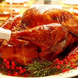 Maple Roast Turkey and Gravy Recipe - This is a New England-style turkey roasted with a maple syrup-butter rub. Try stuffing it with Cranberry, Sausage and Apple Stuffing.