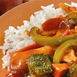 Tomato Chicken Stir-Fry Recipe - Tomato sauce made tangy with soy sauce and vinegar seasons stir-fried vegetables and chicken strips.