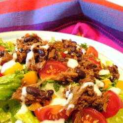 Amy's Barbecue Chicken Salad Recipe - Slices of grilled chicken are tossed with lettuce and Southwest-style ingredients, then served with a creamy barbeque sauce dressing.