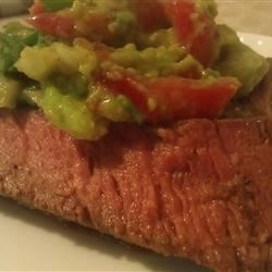 Flank Steak with Avocado Salsa Recipe - A spicy chili-flavored rub is used to add depth and complexity to grilled flank steak. Top with cool and creamy avocado salsa, roll up in a warm corn tortilla, and you have a wonderful summer meal.