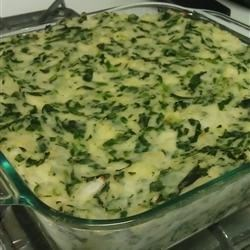 Potato Spinach Casserole Recipe - Mashed potatoes and chopped spinach are baked with sour cream, butter and chives, and shredded Cheddar cheese is melted on top.