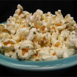 Truffle Lovers' Popcorn Recipe - Your bowl of microwaved popcorn gets a gourmet touch when it's flavored with truffle oil and Parmesan cheese.