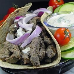 Venison Gyros Recipe - Venison strips are marinated in cumin, marjoram, and oregano for a wild game meat twist on the classic Greek sandwich.