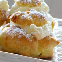 Cream Puffs Recipe and Video - Homemade cream puffs will wow your guests, but they are so easy to make, especially if you fill them with instant vanilla pudding. The baked puff shells are a simple alchemy of milk, butter, water, salt and eggs. Presto!