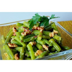 Lemon Green Beans with Walnuts Recipe - Steamed green beans tossed with butter, lemon zest, lemon juice and toasted walnuts. This is excellent with asparagus also. Pecans can be substituted for walnuts.