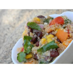 Southwestern Quinoa Salad Recipe - Quinoa makes a delightful grain salad when mixed with corn, black beans, tomato, fresh cilantro, and feta cheese.