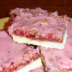 Gooey Cherry Bars Recipe - A shortbread crust is topped with a cherry and walnut custard layer and a barely cherry frosting.