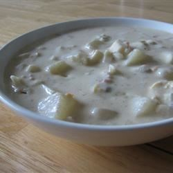 Emma's Slow Cooker Clam Chowder Recipe - It's nice to come home to a big pot of Manhattan-style clam chowder, with tomatoes, potatoes, and bacon, that's been slow-cooking all day.