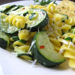 Zucchini Pasta Recipe - Pick some fresh zucchini from your garden, boil it lightly, then add it to a saute of garlic, olive oil and pepper flakes. Toss in some parsley, give it all a quick simmer, then you're ready to serve it up with pasta and Parmesan cheese.