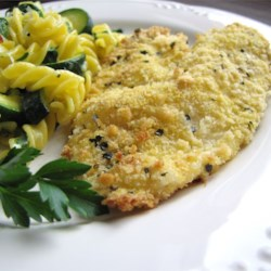 Crunchy Oven Fried Tilapia Recipe - Tilapia fillets baked in the oven with a light cornmeal and basil coating that taste close to being fried, but without all the fat and calories.