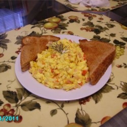 Smoky Scrambled Eggs Recipe - Easy scrambled eggs get jazzed up with dill weed, bell pepper, onion, ham, and a touch of mayonnaise and half-and-half.