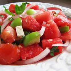 Watermelon and Tomato Salad Recipe - A light and tangy combination of watermelon, tomato and mint creates a delicious combination of sweet, sour and salty flavors.