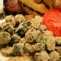 Oven Fried Okra Recipe - Cut okra is tossed seasoned cornmeal and panko breadcrumbs then baked until golden brown and crispy.  This recipe for oven fried okra is sure to become a family favorite.