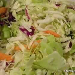 Grandma's Pepper Slaw Recipe - This recipe for sweet and sour cabbage slaw couldn't be simpler to make! Try it as a side dish for grilled burgers, hot dogs, roast pork, or beef.