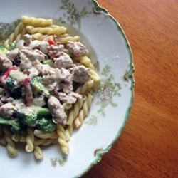 Sausage-Broccoli Pasta Recipe - Sausage, sun-dried tomatoes and chopped broccoli rabe cook in a creamy, cheesy sauce with corkscrew pasta.