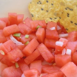 Watermelon Vidalia(R) Salsa Recipe - This salsa features watermelon in place of tomatoes, as well as sweet onion, garlic, and serrano peppers.