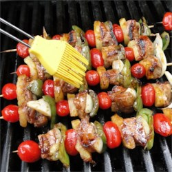 Easy Teriyaki Kabobs Recipe - Bite-sized cubes of pork tenderloin are skewered with a colorful mixture of pineapples, tomatoes, and bell peppers, then grilled to perfection.