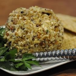 Aunt Rose's Cheese Ball Recipe - A smooth blend of cheeses, olives, and green onions results in a delicious cheese ball rolled in nuts!