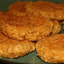 Vegan Baked Oatmeal Patties Recipe - Cooked oatmeal combined with onion, oil, spaghetti sauce, pecans, yeast and spices, and baked into hamburger-style patties. Excellent smothered in mushroom soup and sour cream.