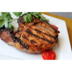 Summer Grilled Pork Chops Recipe - This dish is what summer and grilling are all about...sweet honey and lemon-grilled pork chops are always an entertaining hit. For best flavor, marinate the chops in the honey-lemon marinade overnight.