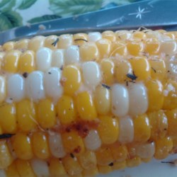 Sweet Grilled Corn Recipe - A perfect summertime side dish of fresh sweet corn grilled in a savory herb mixture.