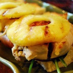 Grilled Chicken Pineapple Sliders Recipe - Marinated grilled chicken breast, grilled sliced pineapple, red onion, and lettuce are sandwiched between sweet Hawaiian bread rolls.