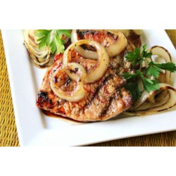 Soy and Honey Pork Chops Recipe - Grilled pork chops brushed with a honey-soy sauce mix are served with grilled slices of sweet onion. There's no marinating time for the sauce, you just mix it and brush it on.