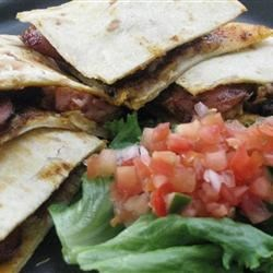 Polish Sausage Corn Chip Quesadillas Recipe - An unusual combination of ingredients combines into a tasty lunch treat.
