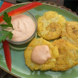 Tostones (Twice Fried Green Plantains) with Mayo-Ketchup Dipping Sauce Recipe - Crispy, twice-fried plantains are delicious with a simple dipping sauce of mayonnaise and ketchup.