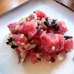 Ahi Poke Salad Recipe - This fresh and bright Hawaiian ahi tuna salad can be served as an appetizer or a summer entree. It is traditionally made with a stringy seaweed called limu ogo and inamona, ground roasted kukui nuts.
