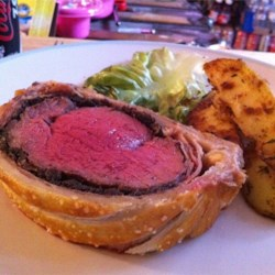 Beef Wellington Recipe - Filet of beef tenderloin is assembled with liver pate, mushrooms and onions, then wrapped in packaged puff pastry. It bakes quickly and makes a beautiful dinner party entree.