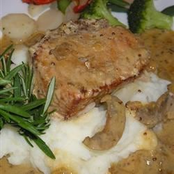 Pork Tenderloin with Creamy Dijon Sauce Recipe - This pork tenderloin cooks all day in the slow cooker with a creamy Dijon and sour cream sauce. It melts in your mouth. Serve it with mashed potatoes and roasted green beans.