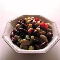 Red, White and Black Bean Salad Recipe - This bean salad is best served at room temperature after being chilled in the refrigerator overnight to allow the flavors to meld, but can be enjoyed immediately if you're in need of a quick dish.
