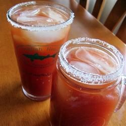 Joe's Famous Michelada Recipe - Mexicans have been enjoying a cold beer mixed with tomato juice and seasonings for years. Here's a yummy variant made with tomato and clam juice cocktail, lemon juice, and a dash of hot sauce, meant to cool you off on a hot day.