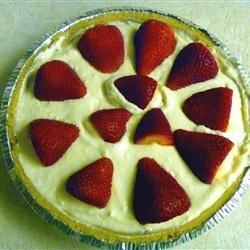 Clarke Cheesecake Pie Recipe - This pie is a snap to make. Cream cheese, milk, vanilla and lots of lemon juice are blended until smooth and creamy. Then the mixture is poured into a graham cracker crust and chilled for a few hours. Garnish with mint and lemon slices.