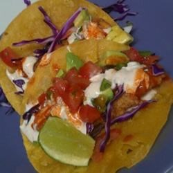 Baja-Style Fish Tacos Recipe - These fish tacos have a delicious tequila-lime-chili flavor and are topped with a crunchy ranchero coleslaw. They are very easy to make. Optional toppings can include black beans, jalapeno peppers, diced tomato, julienned carrots, and green onions.