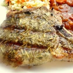 Mediterranean Grilled Pork Chops Recipe - Mix up an easy herb rub with sage, rosemary, fennel, and bay leaf, and the herb mixture will infuse these easy grilled pork chops with delicious Mediterranean flavors over several hours. Grilling them is quick. If it's raining, just broil the chops.