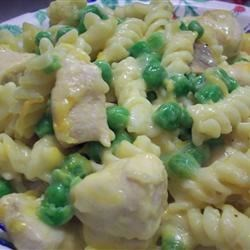Rotini and Chicken Casserole Recipe - Chicken breast is cooked with rotini pasta and cheddar cheese soup in this comfort food casserole that the kids will love.