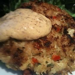 Crab Cakes with Curried Yogurt Sauce Recipe - A spicy yogurt sauce is drizzled over tender, tasty crab cakes. Serve them with rice and make them the main course!