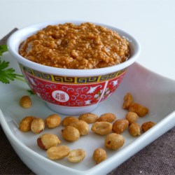 Todd's Famous Thai Peanut Sauce Recipe - Twice-roasted peanuts are ground into a delicious sweet and spicy sauce spiked with hot chili oil and fresh lime juice that's delicious with spring rolls, slathered onto grilled chicken, stirred into cooked noodles, or just eaten as a dip with chips.