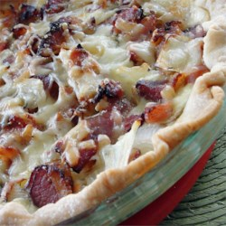 John's Quiche Lorraine Recipe - An eggy quiche rich with cream and bacon is a traditional favorite. Using a premade pie crust makes it easy. Best served warm, not piping hot.