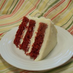 Mom's Signature Red Velvet Cake Recipe - Moist red velvet cake has lots of light and fluffy cooked frosting that's not too sweet -- it's just right.