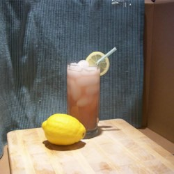 Old-Fashioned Pink Lemonade Recipe - Fresh lemon juice, sugar and water come 'into the pink' with chilled cranberry juice.
